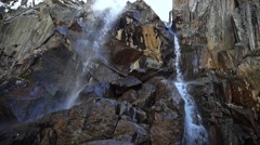 View of the waterfall from the bottom, handheld shooting Stock Footage