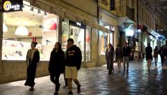 Night city - urban street (pavement) with walking people - stores Stock Footage