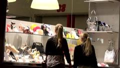Shoes store - shop window - urban street with walking people - night Stock Footage