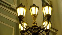 night urban street - lamp - night exterior vintage building - yellow light - stock footage