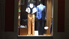 Clothing store - shop window - urban street - nobody - night Stock Footage