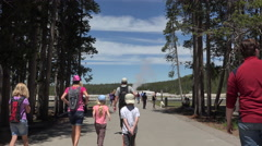 Family walk towards Old Faithful Geyser trail 4K Stock Footage
