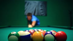 Start Game Blurred man Lines To Hit Ball On Pool Table Stock Footage