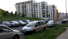 Street (parked cars) with building and nature - steadicam Stock Footage