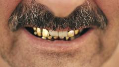 Portrait of an evil man with a mustache, with iron teeth. Close up macro lens Stock Footage