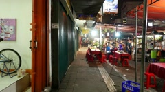 Night cheap restaurant on the street, empty table and seats, asian eatery Stock Footage