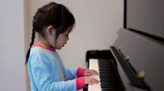Little Girl Playing Piano Stock Footage