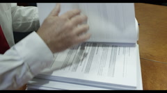 Lawyer reading case Stock Footage