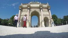 Stock Video Footage of People Cross The Arc de Triomphe du Carrousel