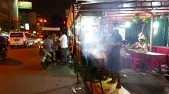 Swirls of smoke from roasting chicken kebab, night street kitchen, man cooking Stock Footage