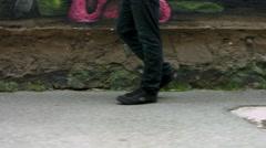 Walking past walls with graffiti Stock Footage