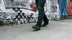 Walking past walls with graffiti - stock footage