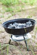 Small grill with smoldering charcoal Stock Photos