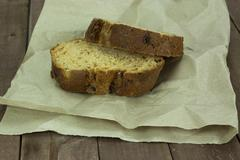 Wholemeal bread on brown paper Stock Photos
