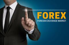 Forex touchscreen is operated by businessman - stock photo