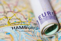 Euro banknotes on a geographical map of Hamburg - stock photo