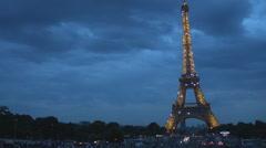 Parisian bridge pont d'Iena with moving cars at night, Paris Eiffel tower lit on - stock footage