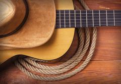 Country music picture with guitar and cowboy hat and rope Stock Photos