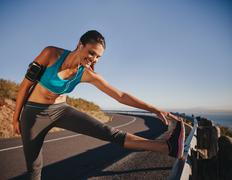 Female athlete getting ready for a run Stock Photos