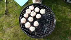 STOCKHOLM, SWEDEN JUNE 2015: Grilling Mushroom in a picnic Stock Footage
