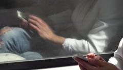 Young attractive blonde woman traveling by train and works on smartphone Stock Footage