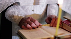 Hands of priest Stock Footage