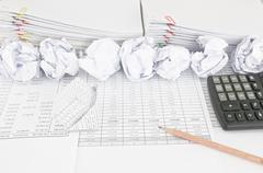 Bankruptcy of house have paper ball with paperwork as background - stock photo