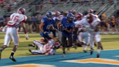 Stock Video Footage of High School Running Back Scores a TD