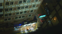 Looking down on a wet Hong Kong street at night 4K Stock Footage