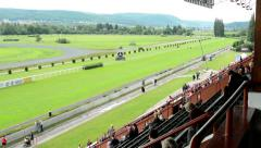 Horse races - audience - people wait for horse race Stock Footage