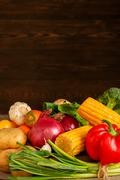 Bunch of vegetables on wooden background Stock Photos