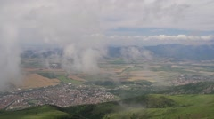 mists evaporate beautiful valley with fields and small villages-timelapse - stock footage