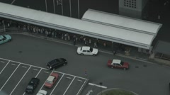 Tourists getting into taxi at taxicab stand in Kyoto Stock Footage