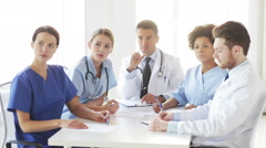 Group of doctors meeting at seminar in hospital Stock Footage