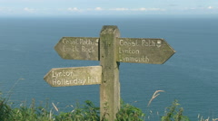 Coast Path Wooden Sign on the South West Coastal Path National Trai Stock Footage