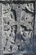 Stone carving - christian cross with mythical creatures in Ejmiadzin,Armenia Stock Photos