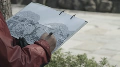 Artist sketching a tree on canvas paper Stock Footage