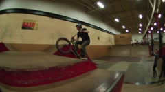 smooth bmx rider boosts a box jump with style - stock footage