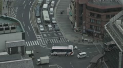Bus and vehicles moving on road at rush hour during the day Stock Footage