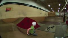 Stock Video Footage of bmx riders bails over a jump