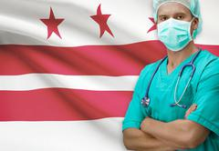 Surgeon with USA states flags on background - District of Columbia - stock photo