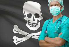 Surgeon with flags on background - Jolly Roger flag Stock Photos