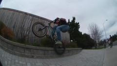 Stock Video Footage of skilled bmx rider doing his street tricks