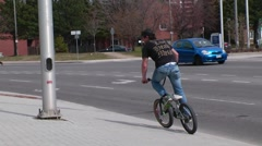 Bmx rider does cool tricks in the street Stock Footage
