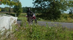 Motorcycle slow motion riding a curve Stock Footage