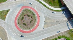 Scenic Aerial Time Lapse of Roundabout, Traffic Driving in Circle Stock Footage