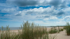 Time lapse of big white clouds moving over a Baltic Sea Stock Footage