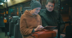 Young people using tablet computer in the bus Stock Footage