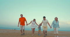 Stock Video Footage of Bih happy family running on the beach