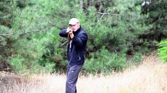 Hunter takes aim at the side of the camera Stock Footage